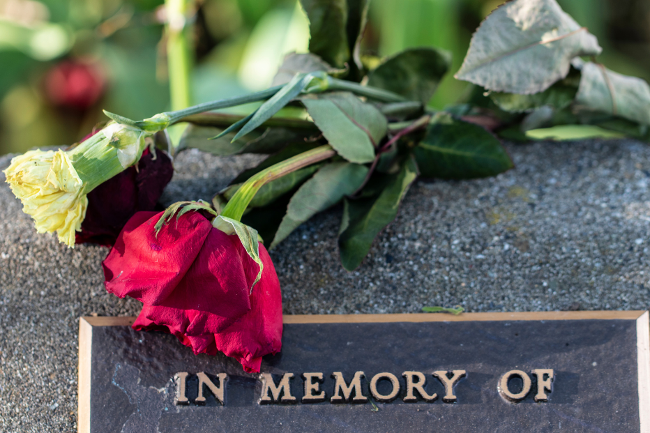 red rose on gravestone | Burial vs. Cremation | Overnight Caskets