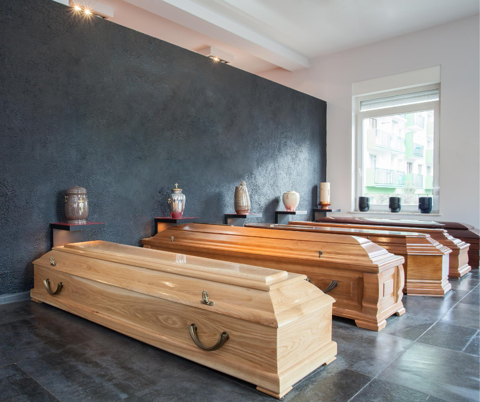 row of wood caskets in display room | Pre-purchase a casket with Overnight Caskets