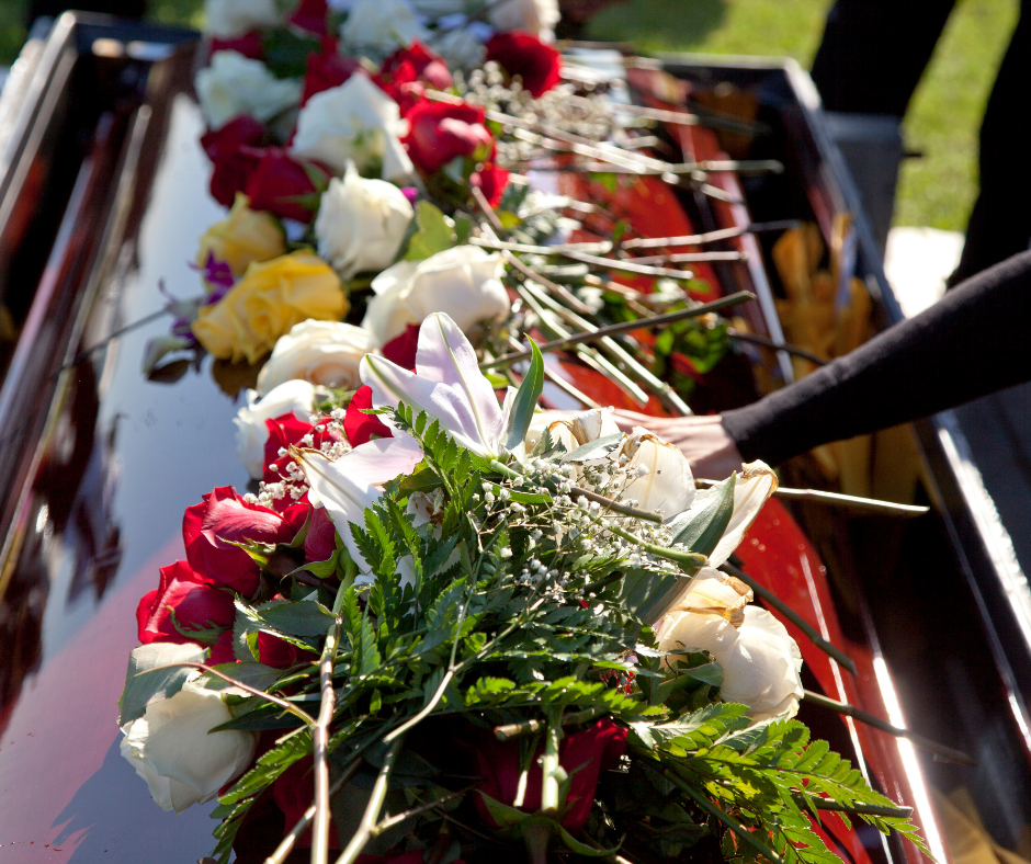 image of flowers on a casket | Funeral Planning During COVID-19 | Overnight Caskets}